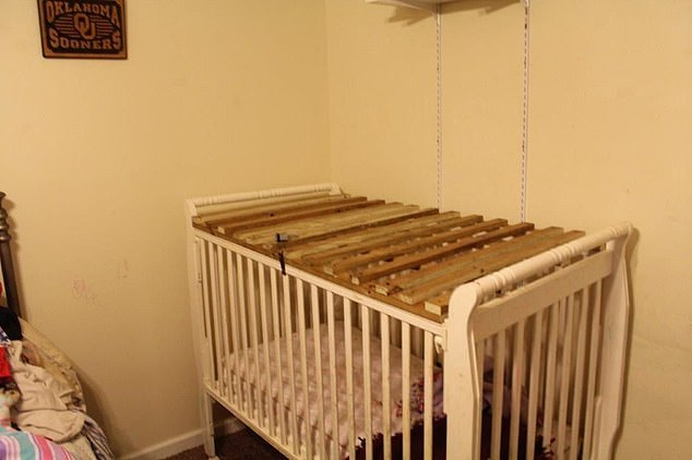 Another photo showed a crib with what appeared to be a similar wooden lid fastened to the top