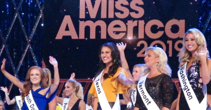 Contestants wave to the audience during introductions at the second night of preliminary competition at the Miss America competition in Atlantic City N.J on Thursday Sept. 6, 2018.
