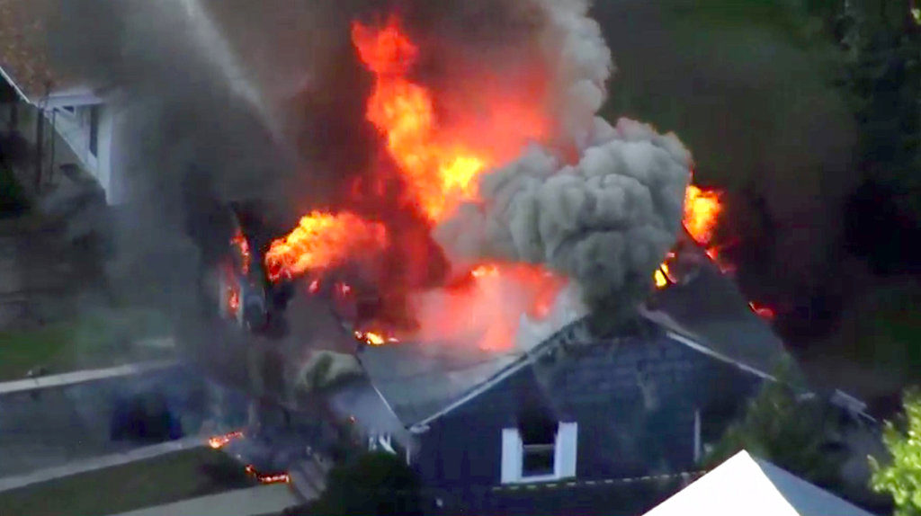 lames consume a home in Lawrence, Mass, a suburb of Boston, Thursday, Sept. 13, 2018. Emergency crews are responding to what they believe is a series of gas explosions that have damaged homes across three communities north of Boston