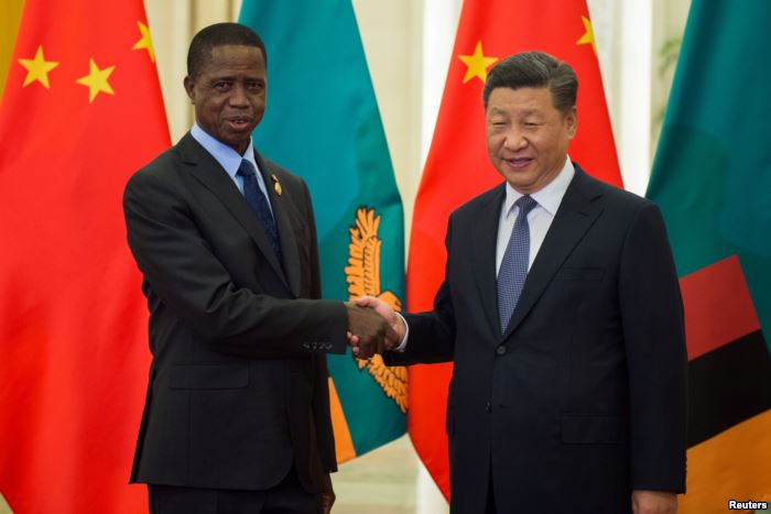 FILE - Zambia's President Edgar Lungu shakes hands with China's Presi