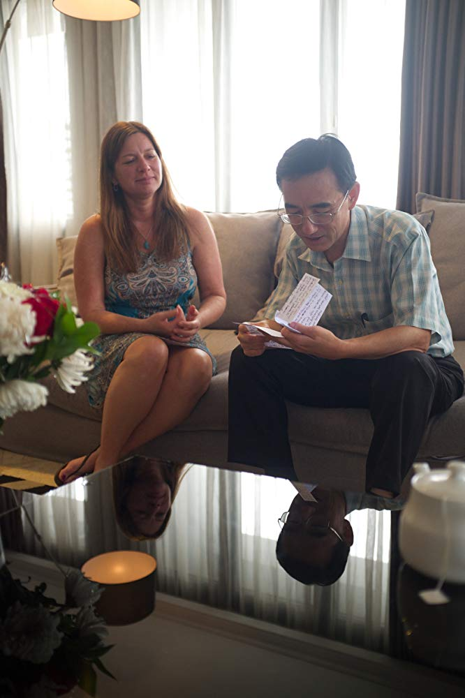 "Julie Keith visits Sun Yi in Jakarta, Indonesia, in ""Letter From Masanjia."" (Flying Cloud Productions)"