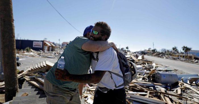 Hurricane survivors wander debris, search for the missing