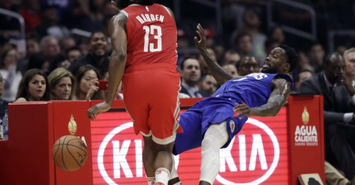 3674cf6c314 ... left, collides with Los Angeles Clippers' Patrick Beverley during the  first half of an NBA basketball game Sunday, Oct. 21, 2018, in Los Angeles.