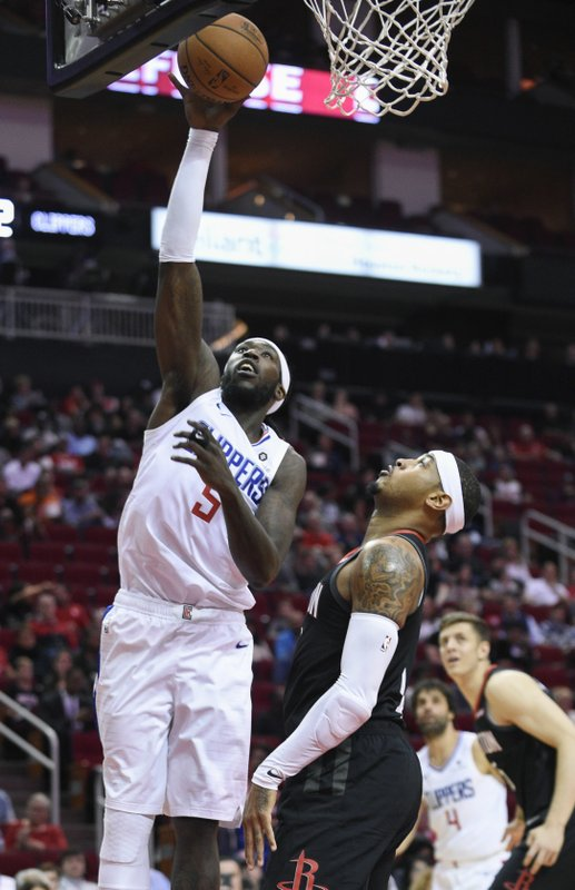 8a8a7c1134d Los Angeles Clippers forward Montrezl Harrell (5) shoots as Houston Rockets  forward Carmelo Anthony