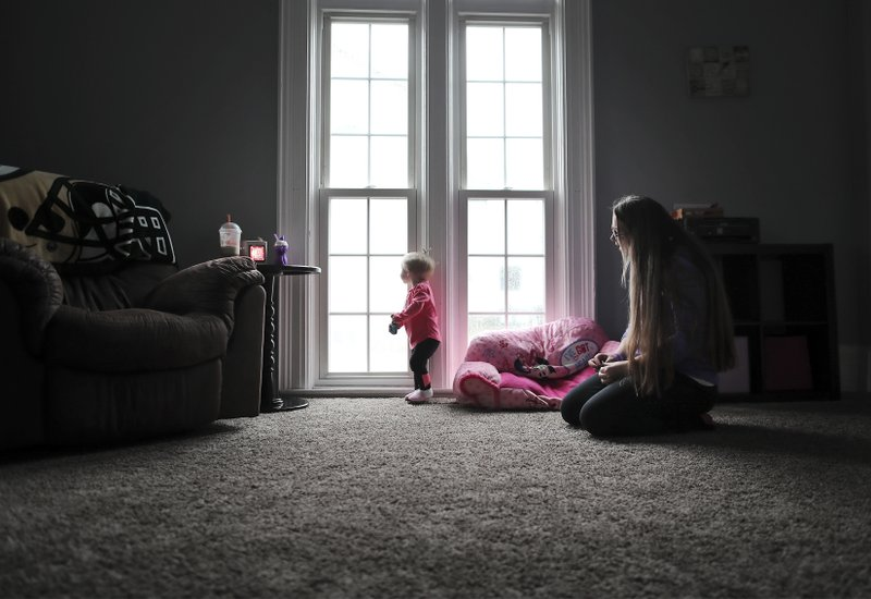 In this 2018 photo, Nicole Shipler plays with her 1-year-old daughter Madison in the living room of their Janesville home. Madison was born two weeks early but weighed only 4 pounds, 11 ounces and stayed in the neonatal intensive care unit for about 10 days as nurses and doctors managed her withdrawal symptoms, Nicole said. (Anthony Wahl/The Janesville Gazette via AP)
