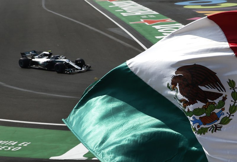Mercedes driver Lewis Hamilton, from Great Britain, drives in a practice run prior to Sunday's Formula One Mexico Grand Prix auto race at the Hermanos Rodriguez racetrack in Mexico City, Friday, Oct. 26, 2018. (AP Photo/Marco Ugarte)