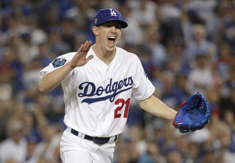 Los Angeles Dodgers starting pitcher Walker Buehler celebrates after the last out in the top of the fourth inning in Game 3 of the World Series baseball game against the Boston Red Sox on Friday, Oct. 26, 2018, in Los Angeles. (AP Photo/Jae C. Hong)