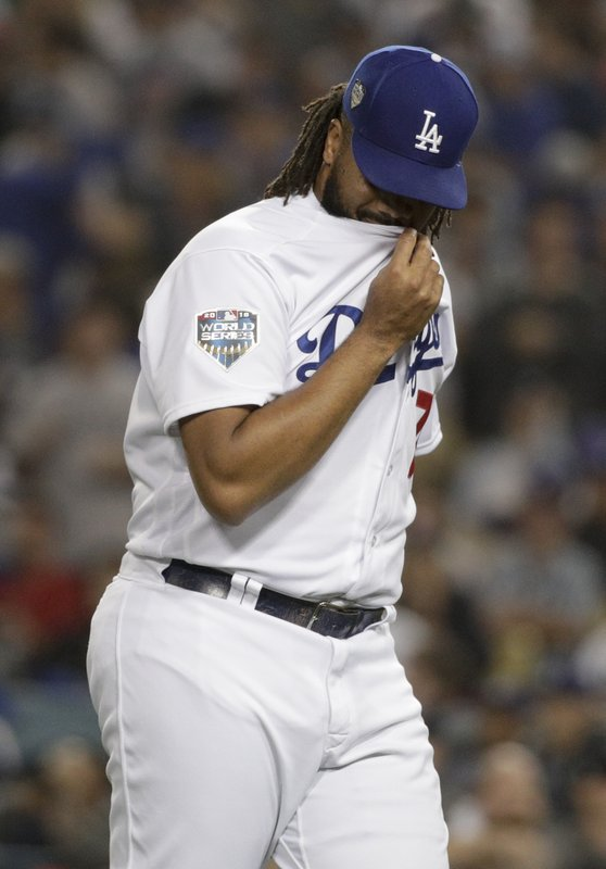 Los Angeles Dodgers relief pitcher Kenley Jansen reacts after giving up a home to Boston Red Sox's Jackie Bradley Jr. during the eighth inning in Game 3 of the World Series baseball game on Friday, Oct. 26, 2018, in Los Angeles. (AP Photo/Jae C. Hong)