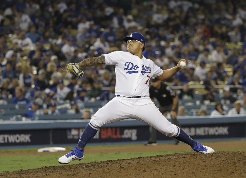 Los Angeles Dodgers pitcher Julio Urias throws during the 17th inning in Game 3 of the World Series baseball game against Boston Red Sox on Saturday, Oct. 27, 2018, in Los Angeles. (AP Photo/David J. Phillip)