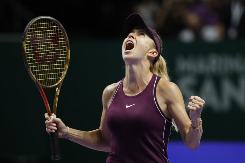 Elina Svitolina of the Ukraine celebrates after winning against Kiki Bertens of the Netherlands during their women's singles semi final match at the WTA tennis finals in Singapore, Saturday, Oct. 27, 2018. (AP Photo/Vincent Thian)