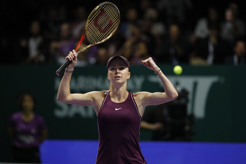 Elina Svitolina of the Ukraine celebrates after winning against Kiki Bertens of the Netherlands after their women's singles semi final match at the WTA tennis finals in Singapore, Saturday, Oct. 27, 2018. (AP Photo/Vincent Thian)