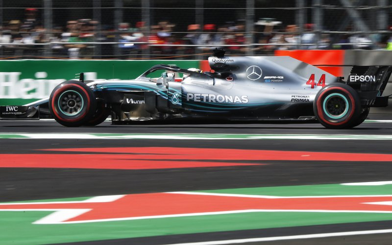 Mercedes driver Lewis Hamilton, from Great Britain, drives in a practice run prior to the Formula One Mexico Grand Prix auto race, at the Hermanos Rodriguez racetrack in Mexico City, Friday, Oct. 26, 2018. (AP Photo/Marco Ugarte)