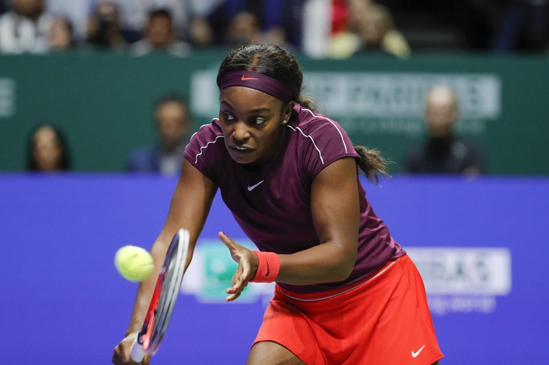 Sloane Stephens of the United States plays a return shot while competing against Elina Svitolina of the Ukraine during their women's singles match at the WTA tennis finals in Singapore, Sunday, Oct. 28, 2018. (AP Photo/Vincent Thian)