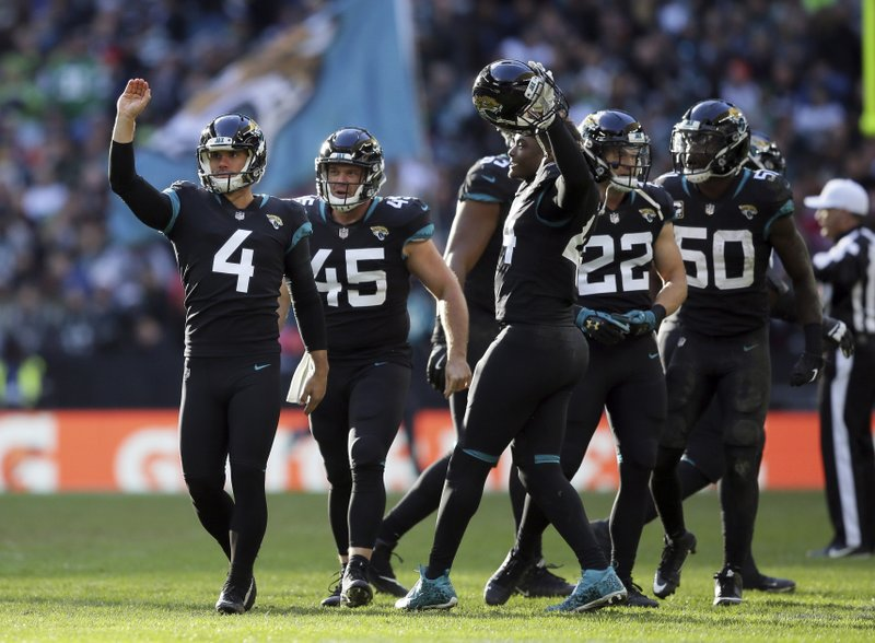 Jacksonville Jaguars kicker Josh Lambo (4) celebrates after scoring a field goal during the first half of an NFL football game against Philadelphia Eagles at Wembley stadium in London, Sunday, Oct. 28, 2018. (AP Photo/Tim Ireland)