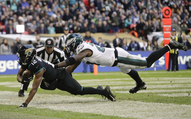 Jacksonville Jaguars wide receiver Dede Westbrook (12) scores a touchdown during the second half of an NFL football game against Philadelphia Eagles at Wembley stadium in London, Sunday, Oct. 28, 2018. (AP Photo/Matt Dunham)