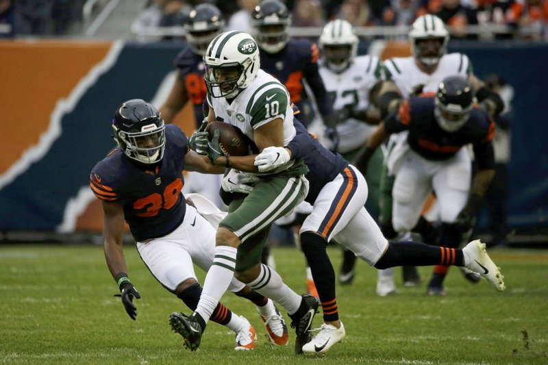 New York Jets wide receiver Jermaine Kearse (10) is tackled by Chicago Bears cornerback Bryce Callahan during the first half of an NFL football game Sunday, Oct. 28, 2018, in Chicago. (AP Photo/David Banks)