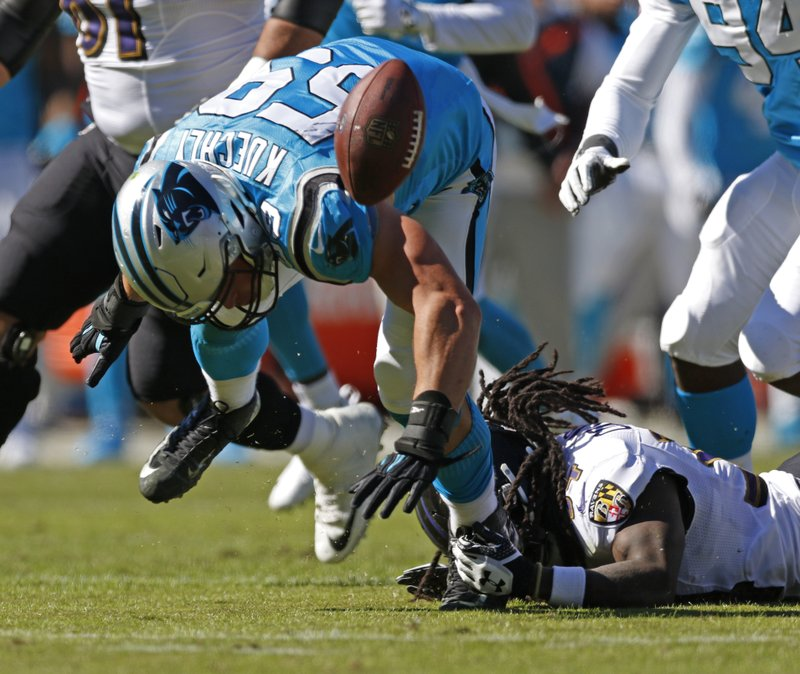 Carolina Panthers' Luke Kuechly (59) chases a fumble by Baltimore Ravens' Alex Collins (34) in the first half of an NFL football game in Charlotte, N.C., Sunday, Oct. 28, 2018. The Panthers recovered the ball. (AP Photo/Nell Redmond)