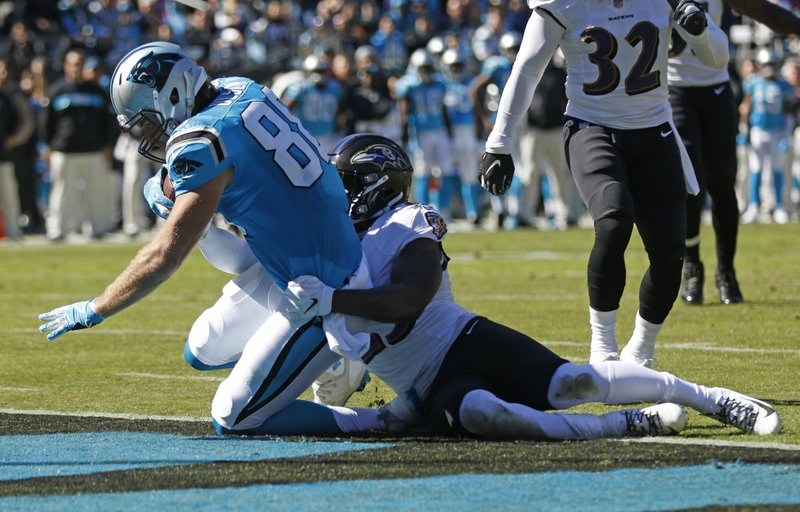 Carolina Panthers' Greg Olsen (88) catches a touchdown pass against Baltimore Ravens' Tony Jefferson (23) in the first half of an NFL football game in Charlotte, N.C., Sunday, Oct. 28, 2018. (AP Photo/Nell Redmond)
