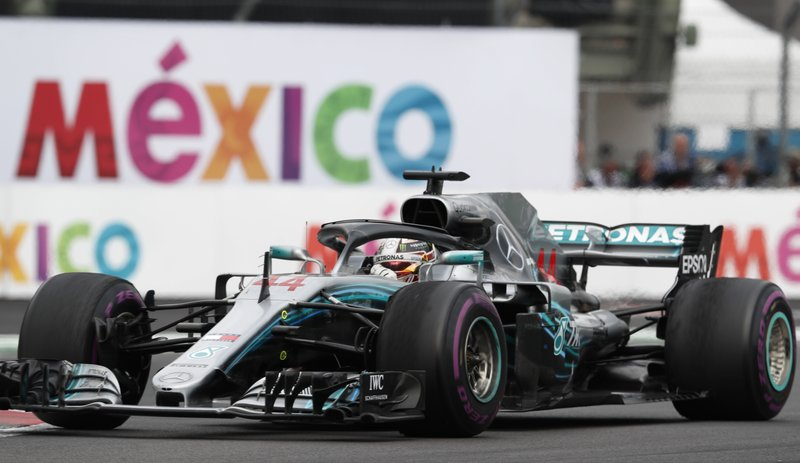 Mercedes driver Lewis Hamilton, of Britain, steers his car during the Formula One Mexico Grand Prix auto race at the Hermanos Rodriguez racetrack in Mexico City, Sunday, Oct. 28, 2018. (AP Photo/Eduardo Verdugo)