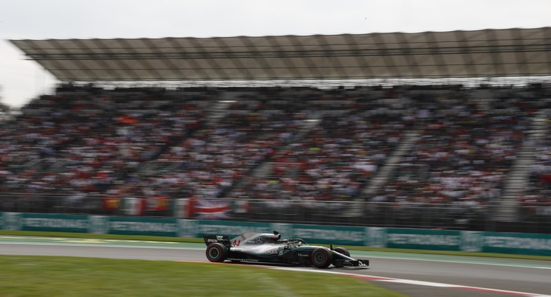 Mercedes driver Lewis Hamilton, of Britain, drives his car during the Formula One Mexico Grand Prix auto race at the Hermanos Rodriguez racetrack in Mexico City, Sunday, Oct. 28, 2018. (AP Photo/Marco Ugarte)