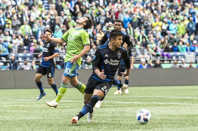 San Jose Earthquakes defender Nick Lima (24) breaks up a drive by Seattle Sounders midfielder Nicolas Lodeiro in the first half of an MLS soccer game in Seattle, Sunday, Oct. 28, 2018. (Bettina Hansen/The Seattle Times via AP)