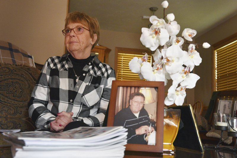 Lynette Johnson talks about her late husband RJ Johnson Wednesday, Oct. 24, 2018, at her home in Sioux Falls, S.D. RJ was killed while on duty as a correctional officer in 2011 by two inmates trying to escape. One of those inmates, Rodney Berget, is being executed. The other inmate, Eric Robert, was executed in 2012. (Briana Sanchez/The Argus Leader via AP)