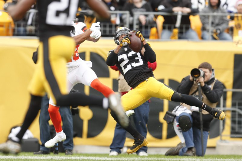 Pittsburgh Steelers cornerback Joe Haden (23) intercepts a pass intended for Cleveland Browns wide receiver Damion Ratley (18) in the second quarter of an NFL football game, Sunday, Oct. 28, 2018, in Pittsburgh. (AP Photo/Don Wright)