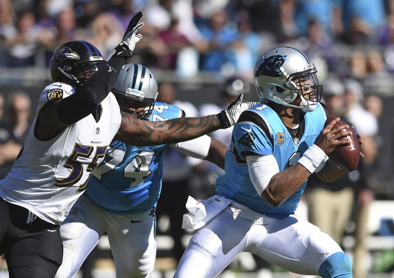 Carolina Panthers' Cam Newton (1) looks to pass under pressure from Baltimore Ravens' Terrell Suggs (55) in the first half of an NFL football game in Charlotte, N.C., Sunday, Oct. 28, 2018. (AP Photo/Mike McCarn)