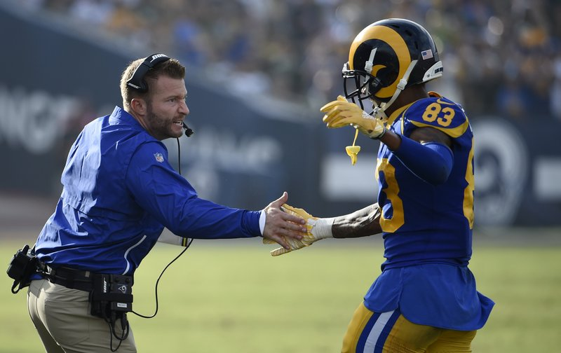 Los Angeles Rams wide receiver Josh Reynolds, right, celebrates his touchdown with head coach Sean McVay, left, during the second half of an NFL football game against the Green Bay Packers, Sunday, Oct. 28, 2018, in Los Angeles. (AP Photo/Denis Poroy)