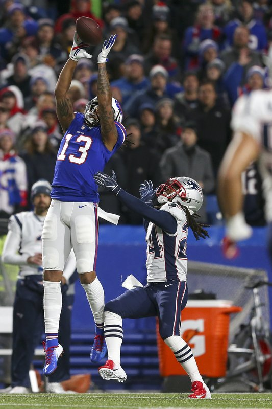 Buffalo Bills wide receiver Kelvin Benjamin (13) makes a catch against New England Patriots cornerback Stephon Gilmore (24) during the second half of an NFL football game, Monday, Oct. 29, 2018, in Orchard Park, N.Y. (AP Photo/Jeffrey T. Barnes)