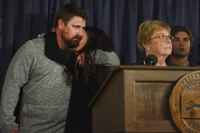 Toni Schafer hugs her brother Jesse Johnson, left, while their mother, Lynette Johnson, third from left, speaks to the media after Rodney Berget is executed Monday, Oct. 29, 2018, at the South Dakota State Penitentiary in Sioux Falls, S.D. Berget was put to death for killing prison guard Ronald