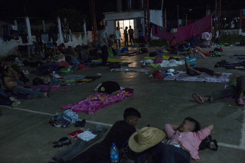 Hondura's migrants gather at a makeshift shelter in Ciudad Hidalgo, Mexico, Monday, Oct. 29, 2018. A second group of Hondura's migrants was able to cross the Suchiate river on rafts — an option now blocked by Mexican Navy river and shore patrols. (AP Photo/Rodrigo Abd)