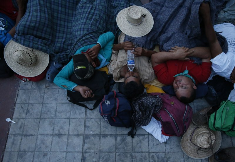 Migrants sleep packed together in a church courtyard at nightfall, as a thousands-strong caravan of Central Americans hoping to reach the U.S. border stops for the night in Niltepec, Oaxaca state, Mexico, Monday, Oct. 29, 2018. As the caravan resumed its slow advance Monday, still at least 1000 miles or farther from the U.S., the Pentagon announced it would send 5,200 active-duty troops to