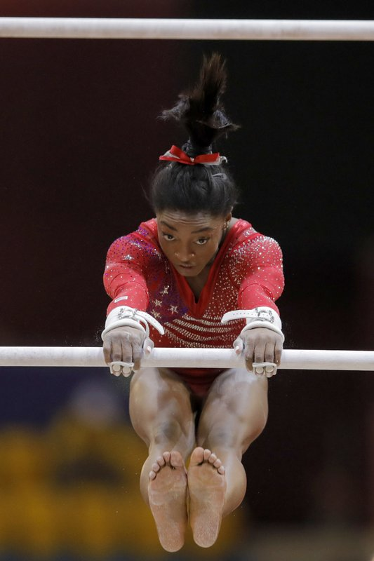 Simone Biles of the U.S. performs on the uneven bars during the women's team final of the Gymnastics World Chamionships at the Aspire Dome in Doha, Qatar, Tuesday, Oct. 30, 2018. (AP Photo/Vadim Ghirda)