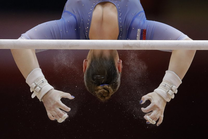 Russia's Aliia Mustafina performs on the uneven bars during the women's team final of the Gymnastics World Chamionships at the Aspire Dome in Doha, Qatar, Tuesday, Oct. 30, 2018. (AP Photo/Vadim Ghirda)