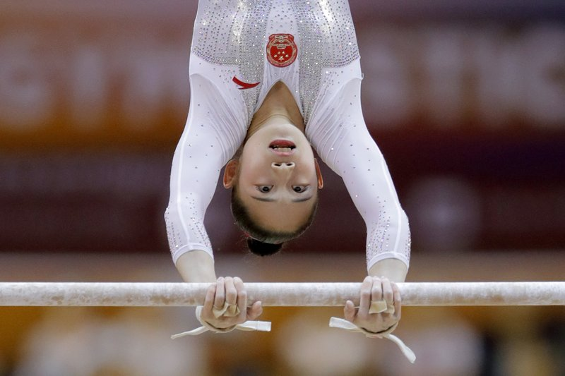 China's Liu Tingting performs on the uneven bars during the women's team final of the Gymnastics World Chamionships at the Aspire Dome in Doha, Qatar, Tuesday, Oct. 30, 2018. (AP Photo/Vadim Ghirda)