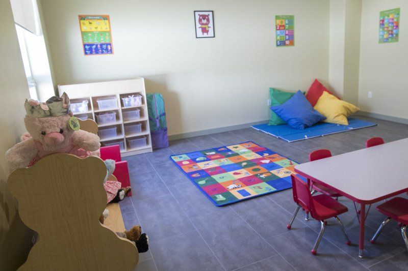 A dedicated children's play area is seen during a tour of a pet friendly domestic violence shelter, Tuesday, Oct. 30, 2018, in New York. The shelter, custom-designed for domestic violence victims to keep their pets in their apartments, has been built in New York City. Organizers say it's the first custom-built, pet-friendly shelter of its size. (AP Photo/Mary Altaffer)
