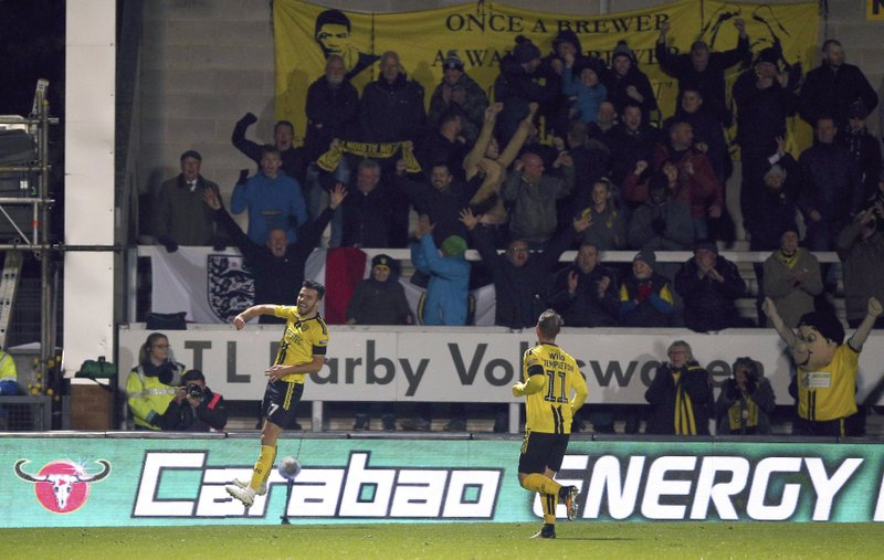 Burton Albion's Scott Fraser celebrates scoring his side's second goal of the game, during the fourth round English Football League Cup soccer match between Burton Albion and Nottingham Forest,  at the Pirelli Stadium, in Burton, England, Tuesday, Oct. 30, 2018. (Nigel French/PA via AP)
