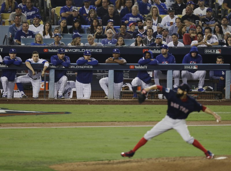 Los Angeles Dodgers watch as Boston Red Sox's David Price pitches during the sixth inning in Game 5 of the World Series baseball game on Sunday, Oct. 28, 2018, in Los Angeles. (AP Photo/Elise Amendola)