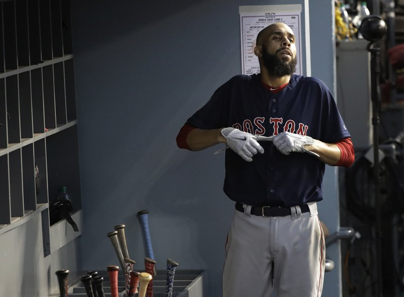 Boston Red Sox pitcher David Price takes his gloves off after batting during the second inning in Game 5 of the World Series baseball game on Sunday, Oct. 28, 2018, in Los Angeles. (AP Photo/David J. Phillip)