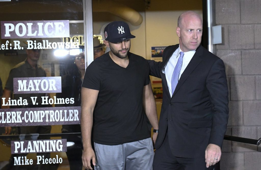 A limousine service operator was charged Wednesday with criminally negligent homicide in a crash that killed 20 people in New York state. Nauman Hussain, 28, showed little emotion as he was arraigned Wednesday evening in an Albany-area court. (Oct. 11)