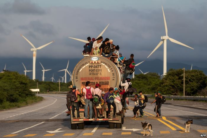 A truck carrying mostly Honduran migrants taking part in a caravan heading to