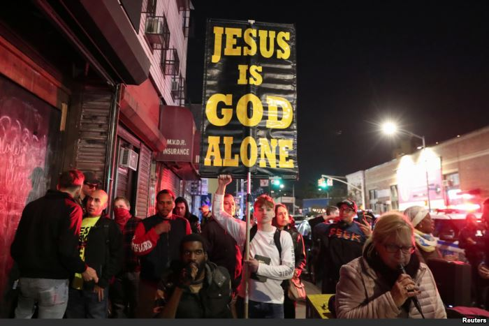 Demonstrators stand outside Catland Books during a ceremony hexing U.S. Supre
