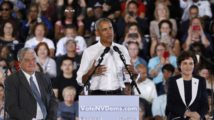 Former President Barack Obama speaks at a rally in support of candidate for S