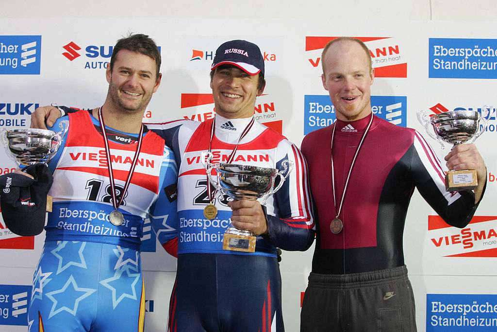 (L to R) Second-placed US Tony Benshoof, Russian winner Albert Demtschenko and third-placed Latvian Martins Rubenis on the podium of the Luge World Cup men event, in Sigulda, Latvia, on Nov. 6, 2005. (Ilmars ZnotinsAFP/Getty Images)