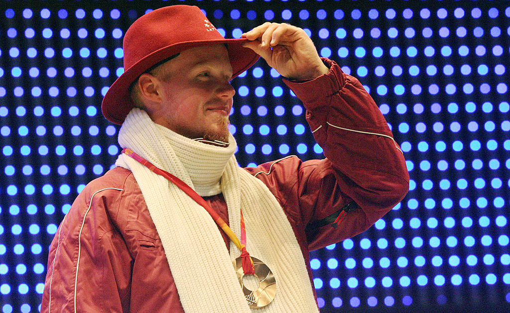 Bronze medalist Latvia's Martins Rubenis celebrates during a 2006 Winter Olympics medal ceremony in Turin, on Feb. 13, 2006. (Thomas Coex/AFP/Getty Images)