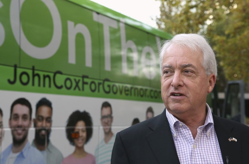 Republican gubernatorial candidate John Cox talks to reporters before beginning a statewide bus tour Thursday, Nov. 1, 2018, in Sacramento, Calif. Cox is running against Lt. Gov., Democrat Gavin Newsom in the Nov. 6 election.(AP Photo/Rich Pedroncelli)