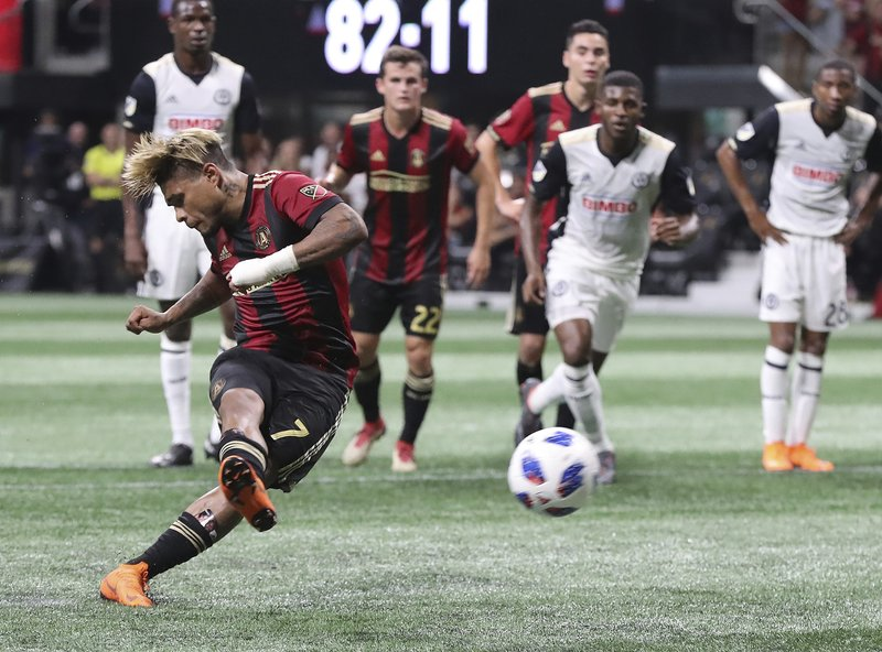 FILE - In this June 2, 2018, file photo ,Atlanta United forward Josef Martinez scores his third goal of the night, on a penalty kick against the Philadelphia Union during the second half of an MLS soccer match in Atlanta. The Atlanta United striker is the winner of the Golden Boot award after putting up 31 goals, easily eclipsing the league record. (Curtis Compton/Atlanta Journal-Constitution via AP, File)