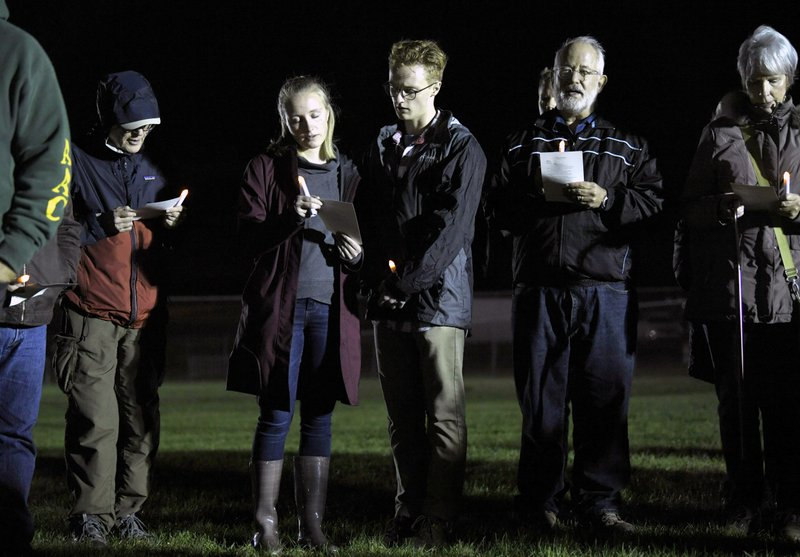 People pray outside of Riverbend Maximum Security Institution Thursday, Nov. 1, 2018, in Nashville, Tenn. Vigils have been organized across Tennessee to oppose the state's plans to put Edmund Zagorski to death in the electric chair. (Shelley Mays/The Tennessean via AP)
