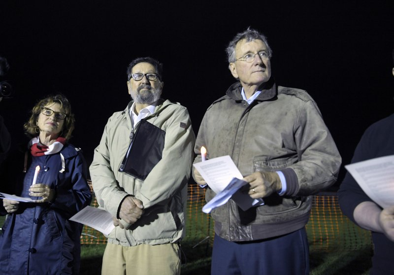 Rev. Joe Ingle, spiritual leader for Edmund Zagorski, right, stands outside with others against the death penalty at Riverbend Maximum Security Institution Thursday, Nov. 1, 2018, in Nashville, Tenn. (Shelley Mays/The Tennessean via AP)